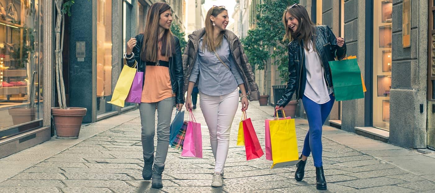 Woman Walking and Carrying Shopping Bags