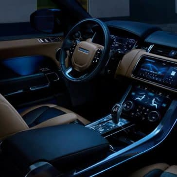 2020 Land Rover Range Rover Sport Interior Front Seating and Dashboard at Night