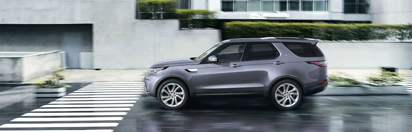 Land Rover Discovery Driving Down Street