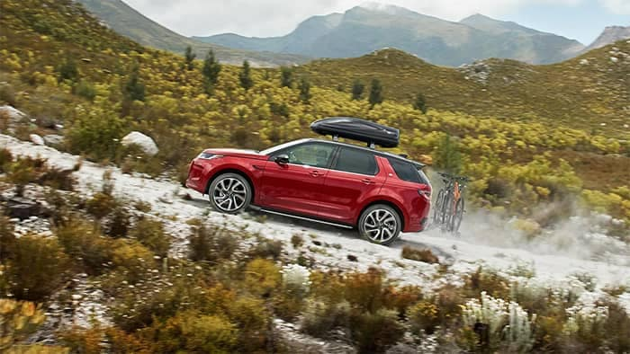 Land Rover Discovery Sport Hauling Bikes and Storage Container up hill