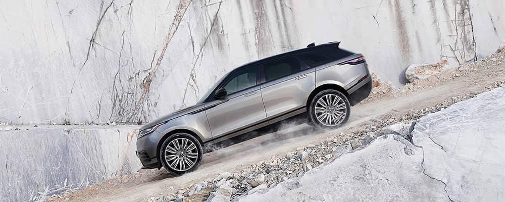 Land Rover Velar Driving Down Gravel Hill