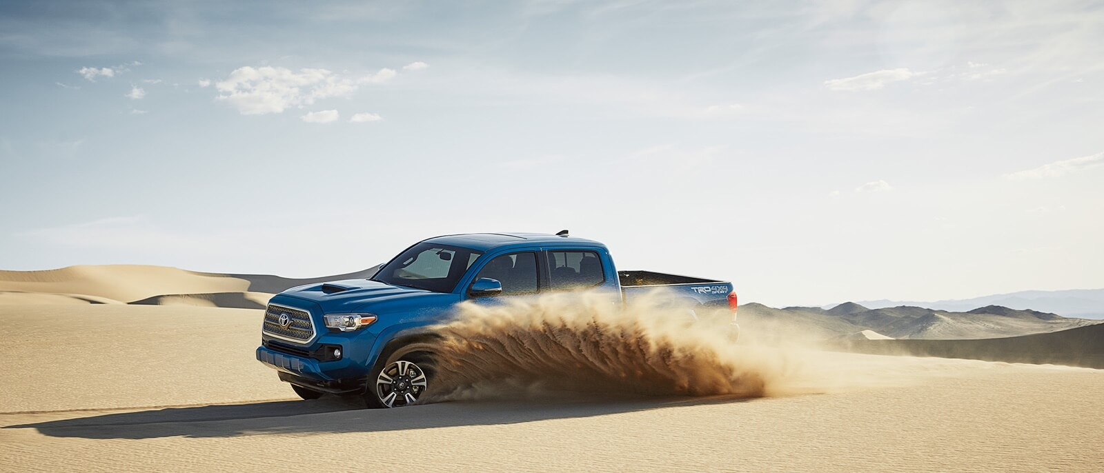 2017 Toyota Tacoma blue exterior model side view