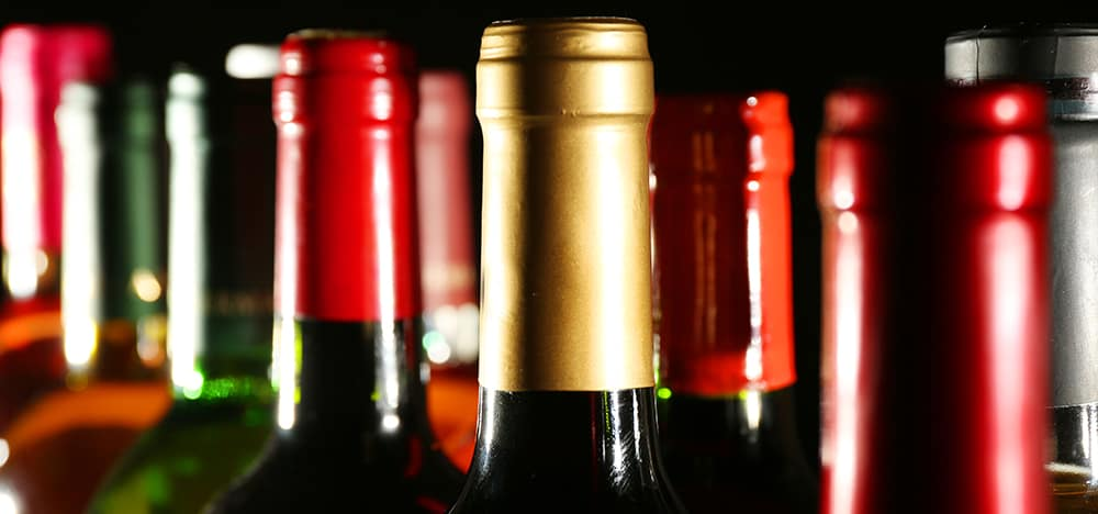 wine bottles in two rows on black background