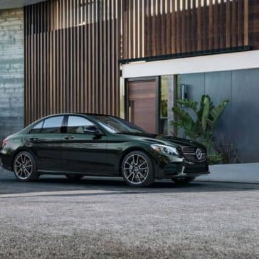 2019 Mercedes Benz C Class Sedan in front of home
