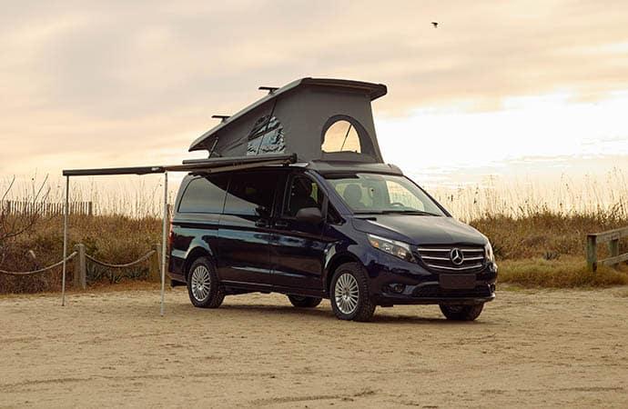 black van with a poptop