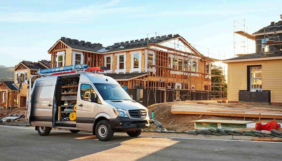 2018 Sprinter cargo van in front of house