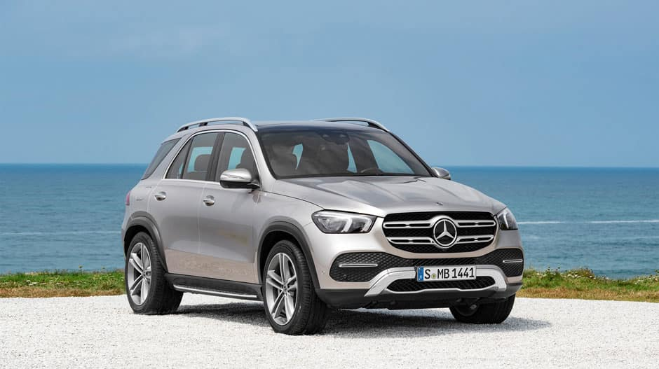 Image of a silver 2020 Mercedes-Benz GLE parked near an ocean.