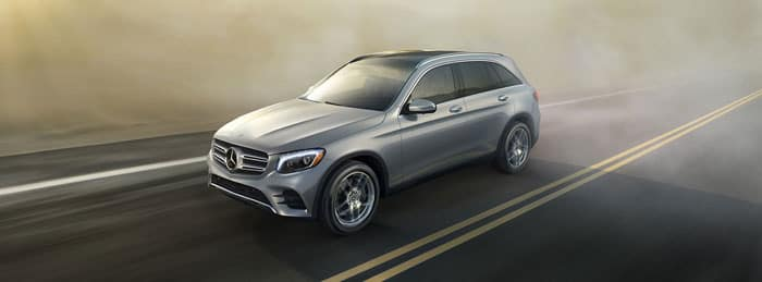Image of a gray Mercedes-Benz GLC driving on a highway through fog.