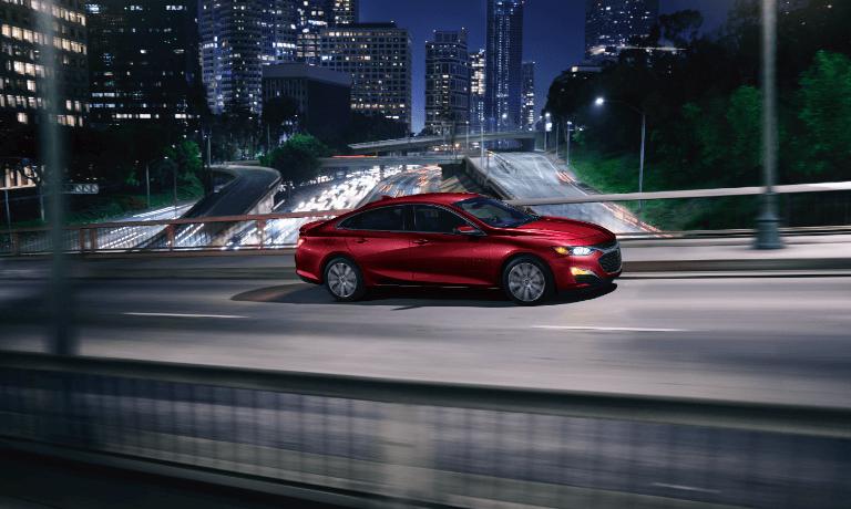 2020 Chevy Malibu driving at night thorugh the city