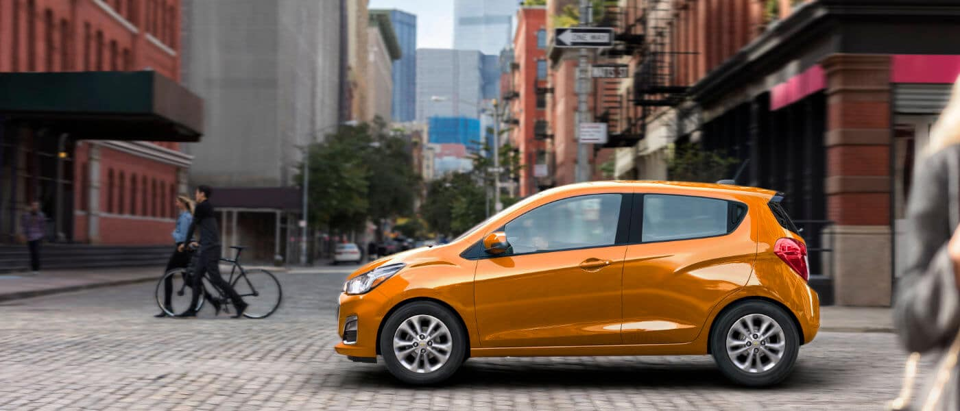 2020 Chevy Spark Drivig in busy city intersection