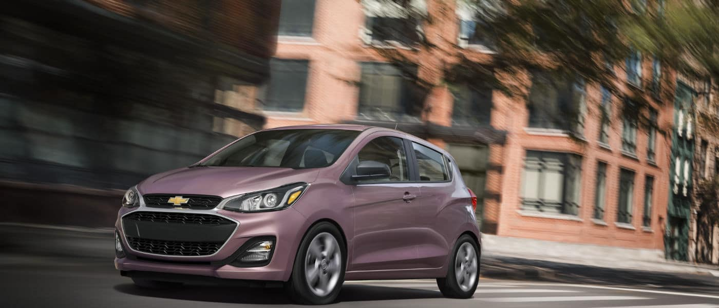 2020-Chevy-Spark-in-pink-driving-throughout-city