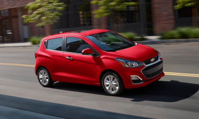 2020 chevy Spark Drivin in red on street