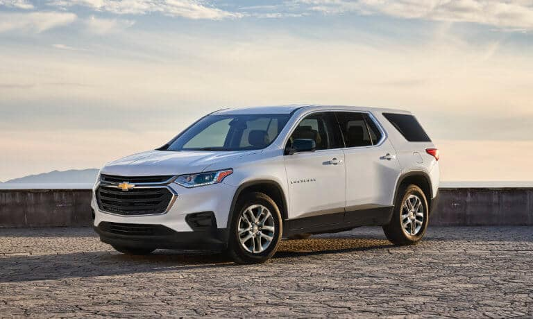 2020 Chevy Traverse Exterior in white parked on stone lookout
