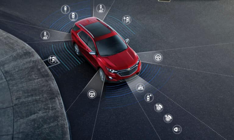 2020 Chevy Equinox in red showing the saftey icons