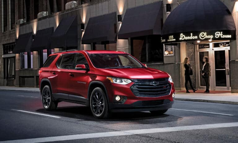 2020 Chevy Traverse driving in the city stoped at red light