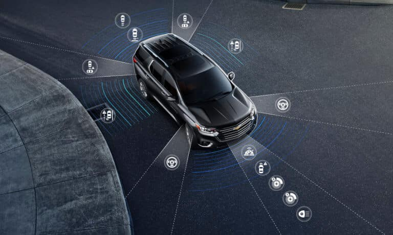 2020 Chevy Traverse in black showing the saftey icons