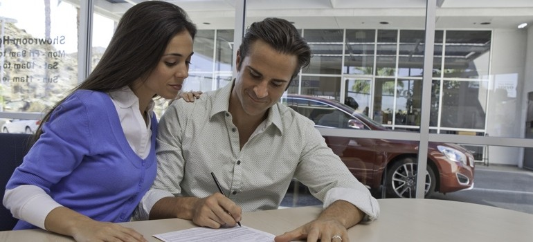 Couple applying for Auto Financing