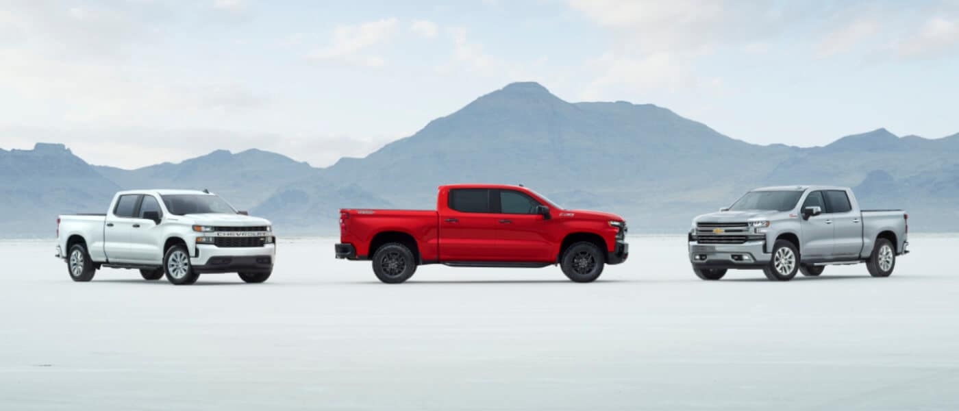 2020 Chevy Silverado 1500 Exterior in red driving Up Snowy Mountain