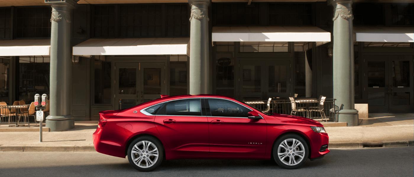 2020 Chevy Impala parked infront of empty resturanut