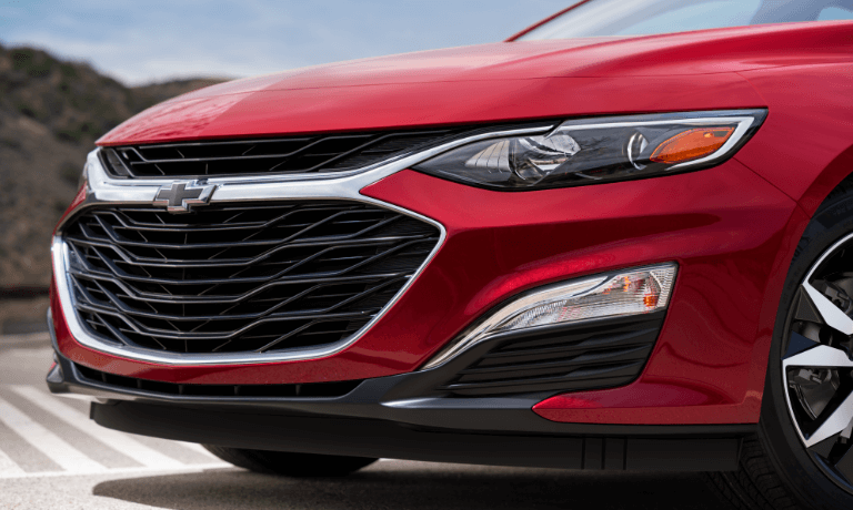 2020 Chevy Malibu in red close up of front grille