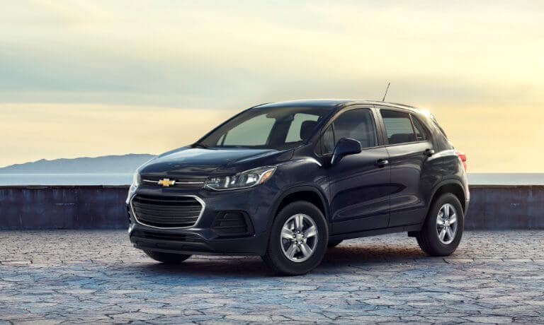 2020 Chevy Trax in dark blue parked on stone coast lookout