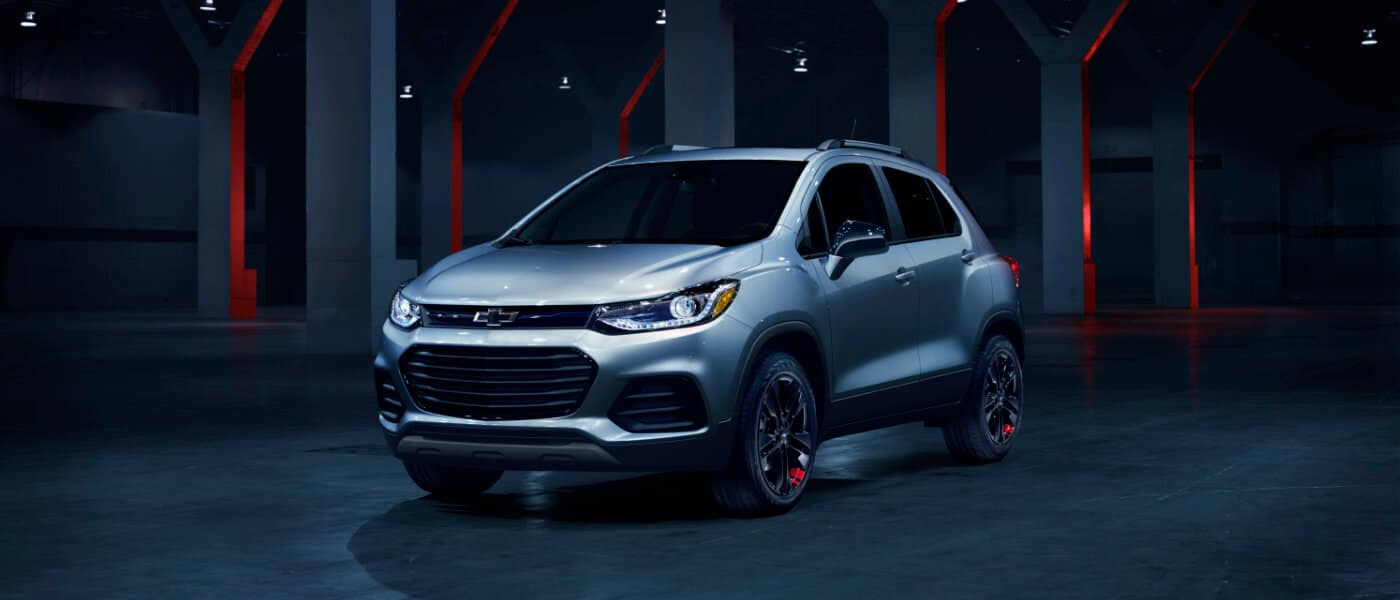 2020 Chevy Trax in silver parked in a dark wearhouse with red lights