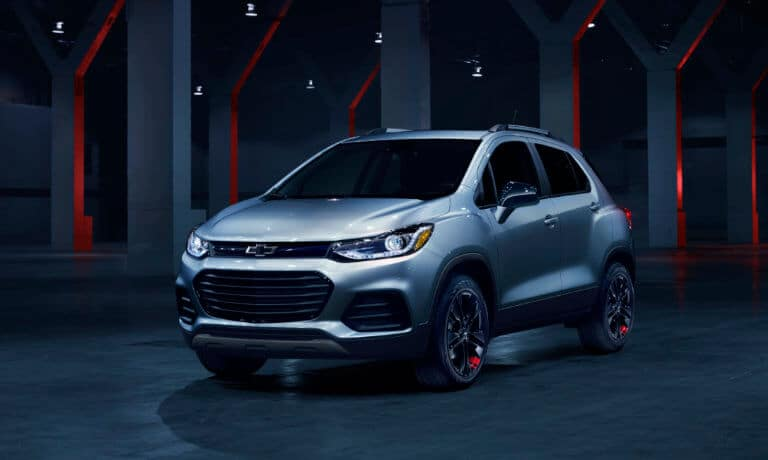 2020 Chevy Trax Driving along a lake front with city skyline behind it