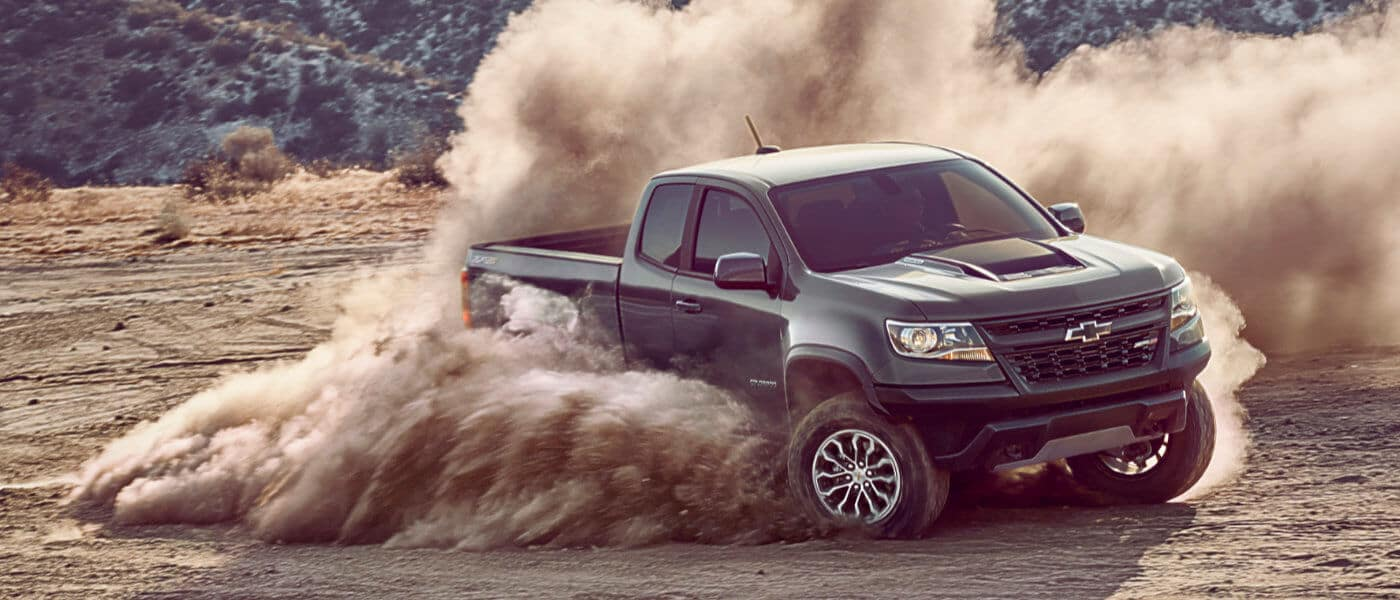 2020 chevy Colorado in black drifting in dirt