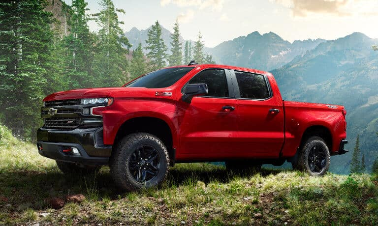 2020 chevy silverado in red parked off road parked in the mountians off road