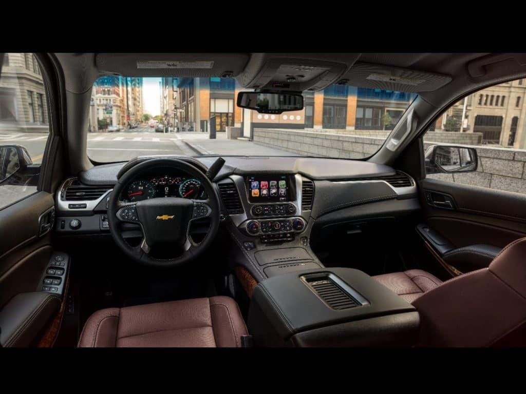 interior of a 2020 Chevy Tahoe with mahogany-colored leather seats and black leather accents throughout the cabin