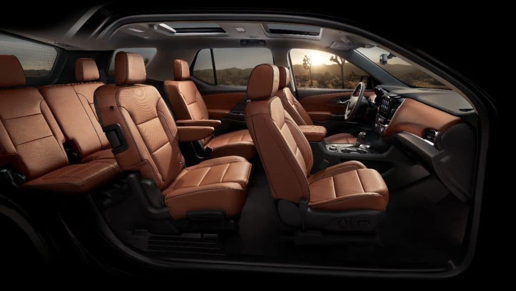 interior of a 2020 Chevy Traverse High Country with three rows of seating and brown leather throughout