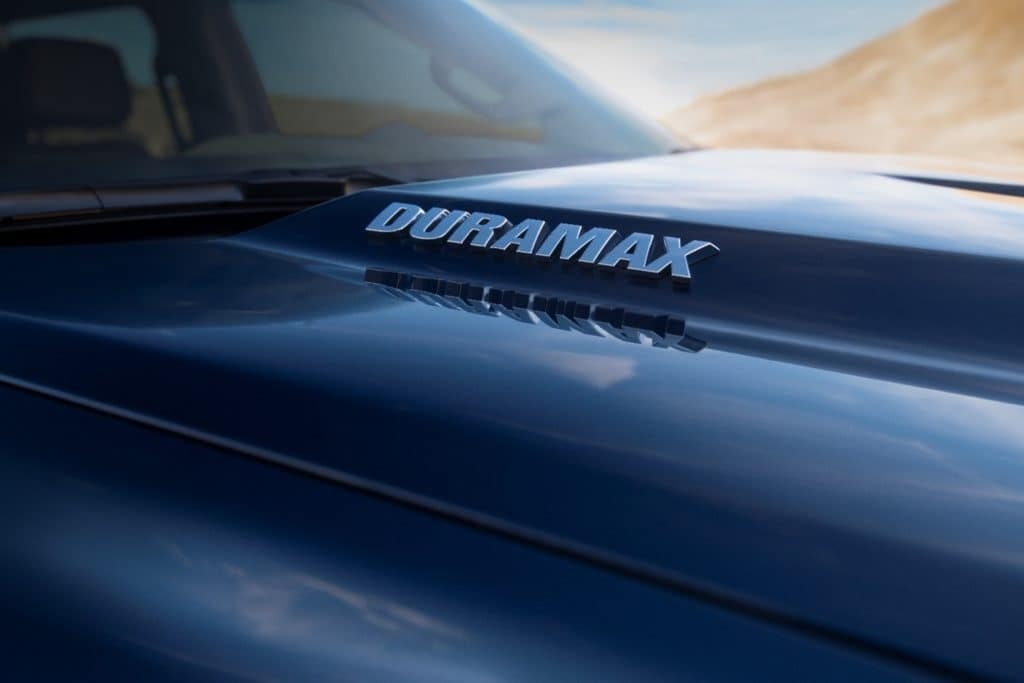 closeup of chrome Duramax® logo on the black hood of a 2020 Chevrolet Silverado 1500 pickup truck