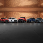 red, white, dark gray, and blue 2019 Chevrolet truck and SUVs parked in a line