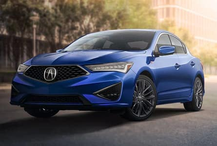 blue 2020 Acura ILX driving through a city