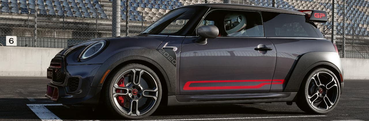 grey mini cooper gp parked on race track