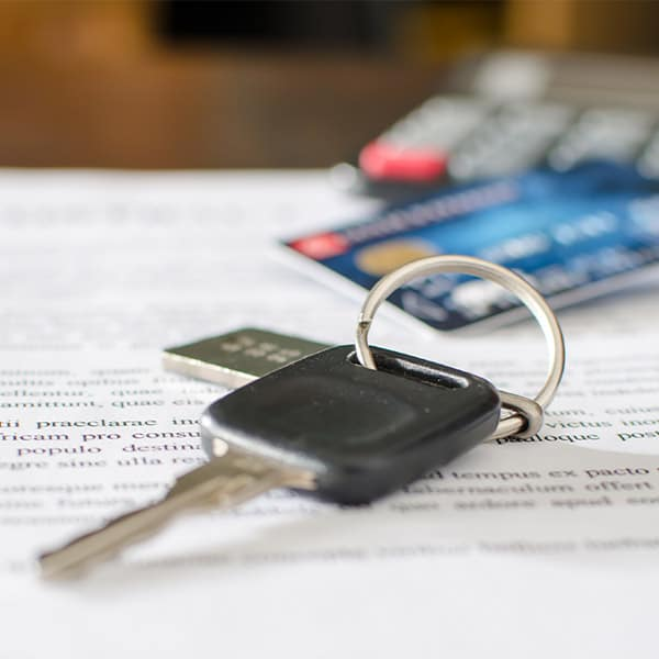 Car key, credit card on a signed sales contract