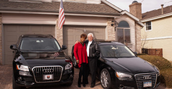 Dan and Vaniece Sinawski with their Audi Q5 and A8L