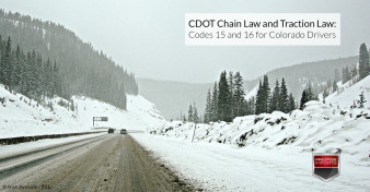 I-70 in the Colorado Mountains covered in snow and ice - CDOT Chain Law and Traction Law - Codes 15 and 16 for Colorado Drivers