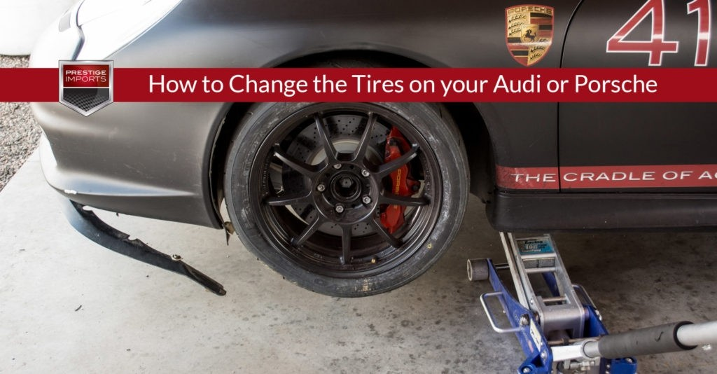 """Prestige Imports Race Car with a damaged front air dam, bumper, and tire from an off-track adventure. Used to illustrate the article, """"How to Change the Tires on your Audi or Porsche""""."""