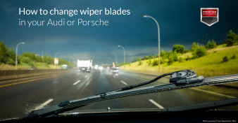 "Windshield wiper blade and rainy windshield with busy highway in the background. Used to illustrate the article ""How to change wiper blades in your Audi or Porsche""."