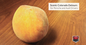 "Palisade peach set on a wooden table. Used to illustrate the article, ""Scenic Colorado Detours for Porsche and Audi Drivers"""