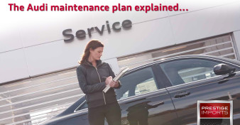 An Audi service advisor checks in her customer's car