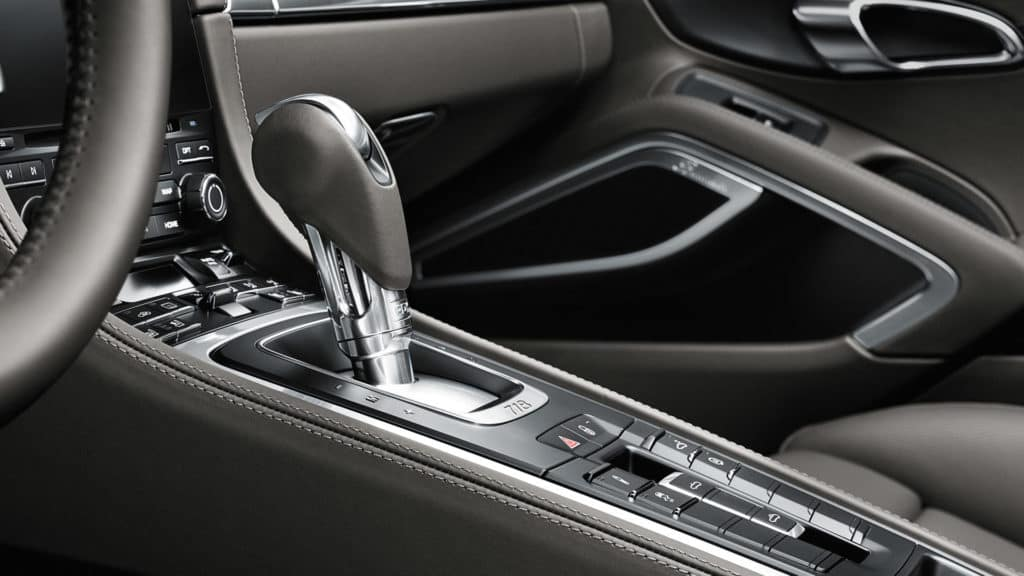 Photo of the PDK shift lever in a Porsche 718 Cayman. Try it out at Prestige Imports, your Denver Porsche dealership, today.