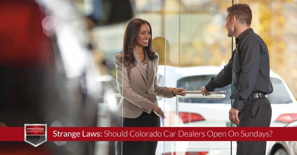 "Photo of a woman greeting a sales person as she enters an Audi dealership. Used to illustrate the article, ""Strange Laws: Should Colorado Car Dealers Open On Sundays?""."