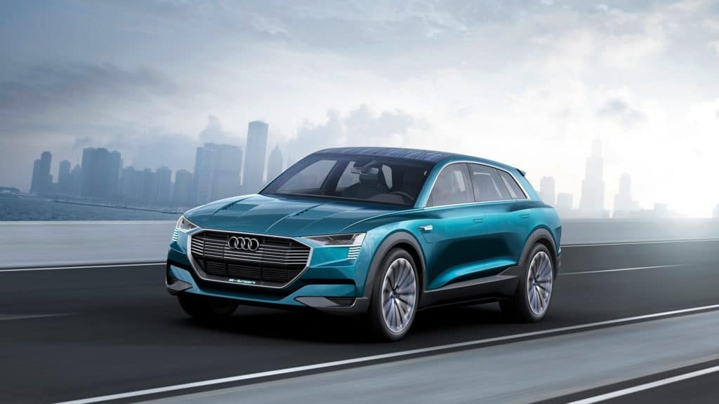 "Front three quarter view photo of the Audi e-tron quattro concept car. Used to Illustrate the article ""Luxury Goes Green - Audi and Porsche Are Moving Forward with Eco Car Design""."