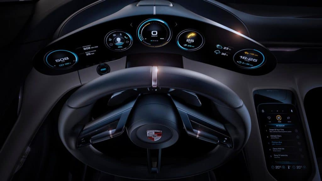 "Cockpit photo of the Porsche Mission E concept car. Used to Illustrate the article ""Luxury Goes Green - Audi and Porsche Are Moving Forward with Eco Car Design""."