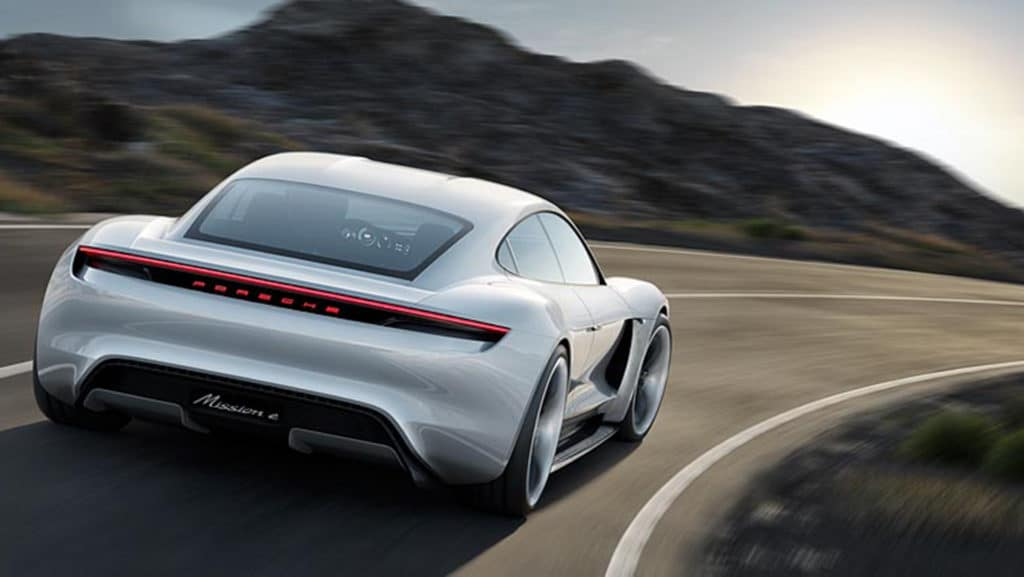 "Rear three quarter view photo of the Porsche Mission E concept car. Used to Illustrate the article ""Luxury Goes Green - Audi and Porsche Are Moving Forward with Eco Car Design""."
