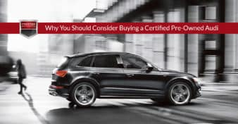 "2016 Audi Q5 driving on a city street. Used to illustrate the article, ""Why You Should Consider Buying a Certified Pre-Owned Audi""."