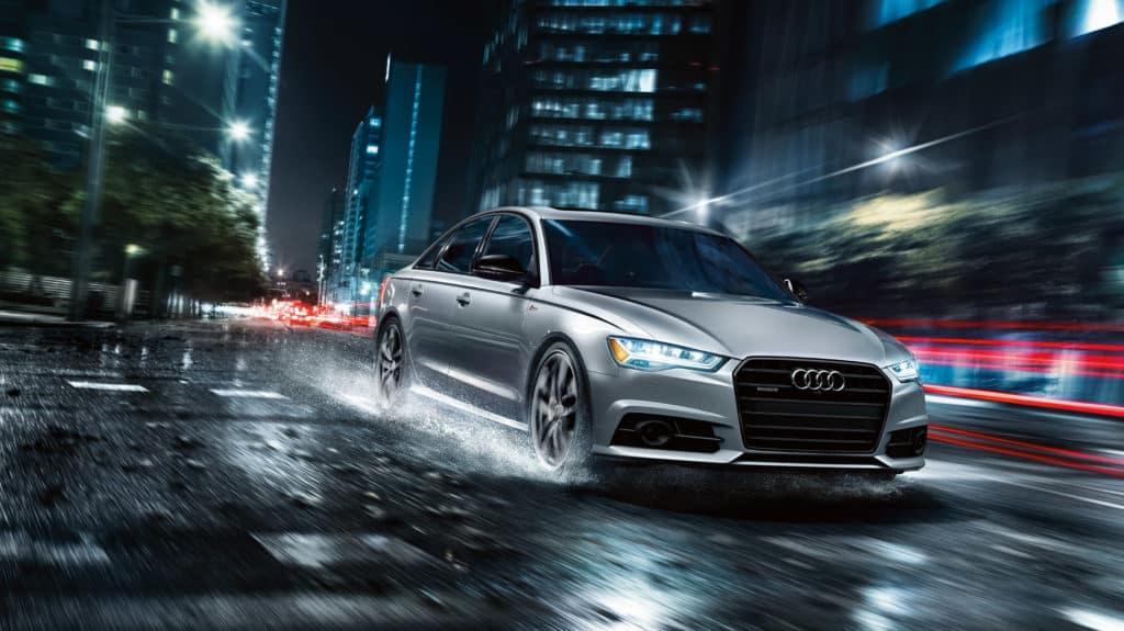 2018 Audi A6 Ext 3.0T Prestige Driving on Rain Front Angle - Florett Silver metallic
