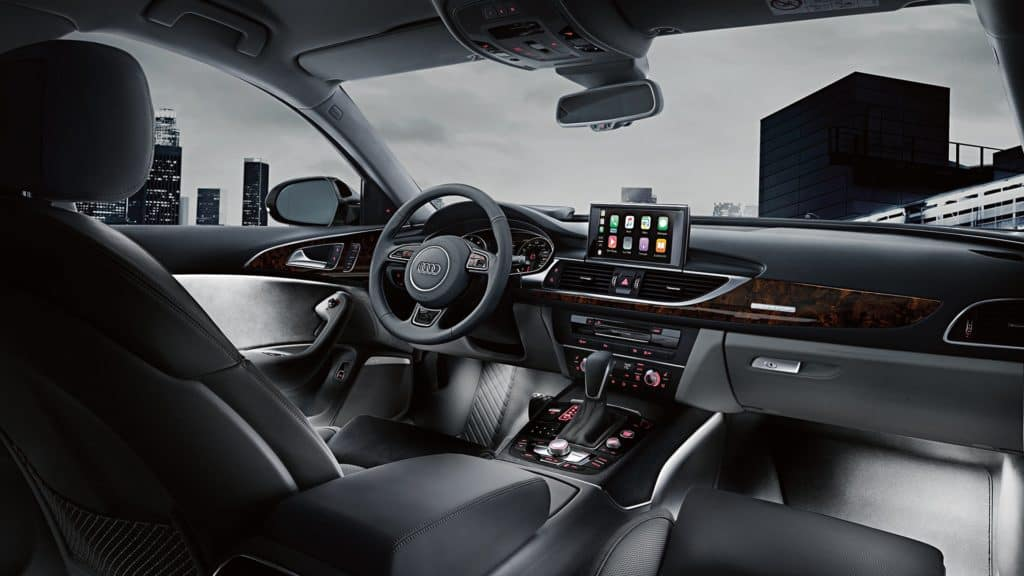 The expansive wraparound dash of the Audi A6 with infotainment display